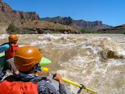 NOLS participants raft through fast-moving white water