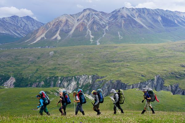 Students backpacking with one of their instructors through the rugged Alaskan landscape.