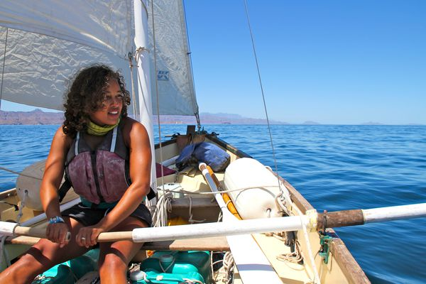 A student uses oars while out on a sailboat in Baja California, Mexico.