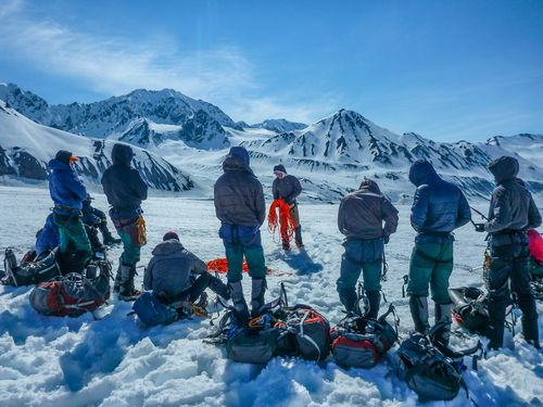Naval Academy students on a NOLS Custom Education course prepare for a day of mountaineering in Alaska.